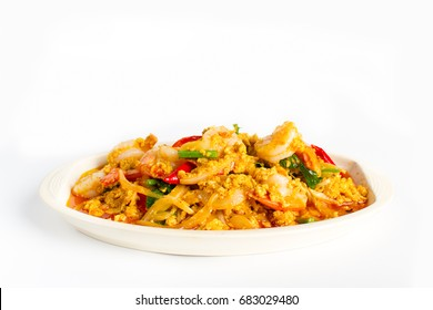 Stir fried shrimp in indian yellow powder with onion and egg on white background
