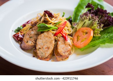Stir fried spaghetti with Thai sausages style.