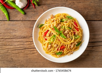 stir fried spicy spaghetti with minced chicken and basil,Pad Kra Pao