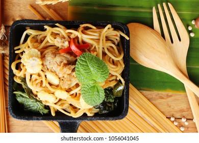 Stir fried spicy spaghetti with pork delicious