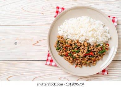 Stir fried Thai basil with minced pork and chilli on topped rice - Thai local food style - Shutterstock ID 1812095734