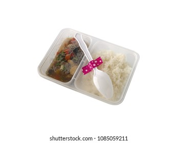 Stir Fried Vegetables and Cooked white rice in package plastic box isolated on white background. thai food