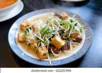 stir fried vegetables of sprouts and tofu serving on beautiful plate