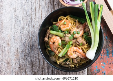 "Stir fried yellow noodle ""mee pad hokkian phuket"" rice yellow noodle with soy sauce, prawn, pork, oyster and egg. Thai food phuket"