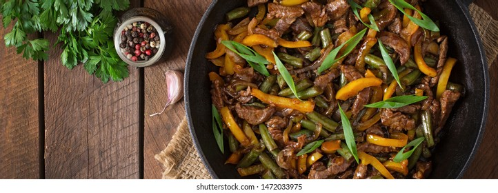 Stir fry of beef and sweet pepper. Asian cuisine. Top view, overhead