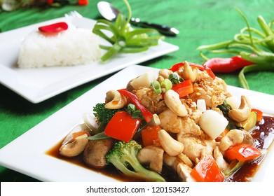 Stir fry chicken cashew nuts with jasmine rice backround