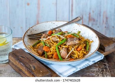 Stir fry duck fillets with noodles, vegetables and hoisin sauce