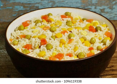 stir fry rice, with corn, peas, carrot and other ingredients