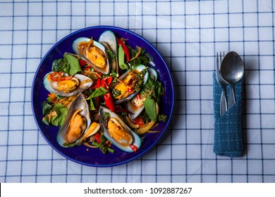 Stir fry spicy mussel on the table