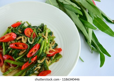 Stir fry spicy water spinach with dried shrimp and red chili, Cah Kangkung, famous Indonesian cuisine