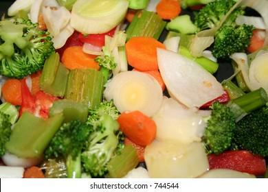 Stir frying crisp vegatables in a wok