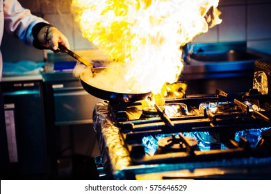stir frying with huge flames around