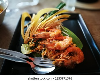 """Stired fried rice noodle in tammarind sauce with fried shrimps. This dish is well known as """"Padthai"""""""