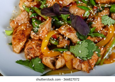 Stir-fried chicken with vegetables and herbs