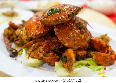 Stir-fried crab with garlic and black pepper, Serrated Mud Crab, black crab, Close up, Chinese food.