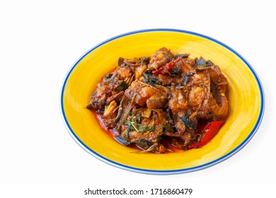 Stir-fried deep fried fish (Asian redtail catfish) with red curry paste. Thai healthy asian food from fish cooked