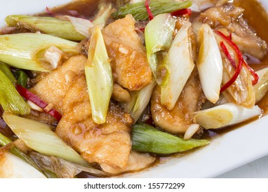Stir-fried fish and vegetable in brown sauce