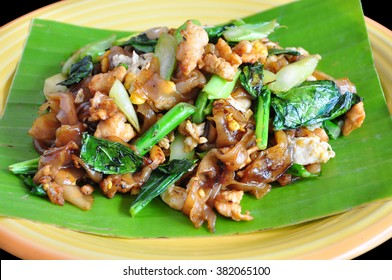 "Stir-fried fresh rice-flour noodles in sweet soy sauce or ""Pad See Ew"" in Thai Language"