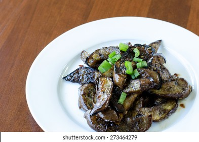 Stir-fried Japanese eggplant on a white plate