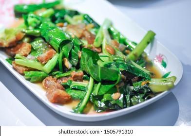 stir-fried kale with crispy pork in oyster sauce