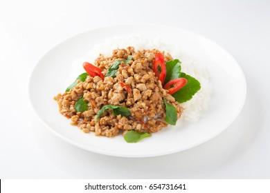 stir-fried with minced pork and basil on white plate (Ka Prao Moo)