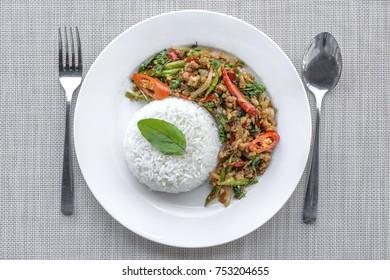 Stir-fried with minced pork and basil on white plate (Pad Ka Prao Moo)