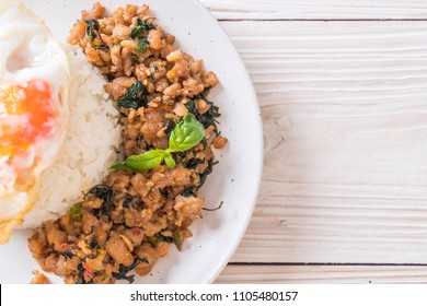 stir-fried pork with basil  on rice and fried egg - Thai traditional food style