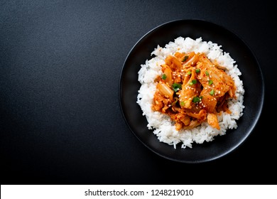 stir-fried pork with kimchi on topped rice - Korean food style