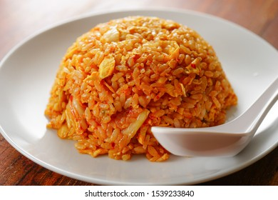 Stir-fried rice with egg and kimchi.
