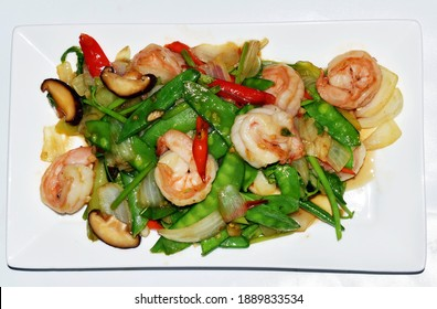 A stir-fried shrimps with nutritional vegetables (onion, mushroom, green pea, chili ) ,it is a very delicious and healthy dish for Asian people.