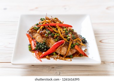 stir-fried spicy and herb with grouper fish fillet  - Thai food style