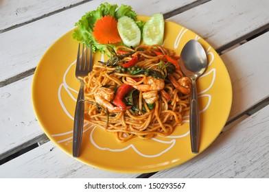 Stir-fried spicy spaghetti with shrimp, also known as drunken spaghetti or Phad Kee Mao Spaghetti