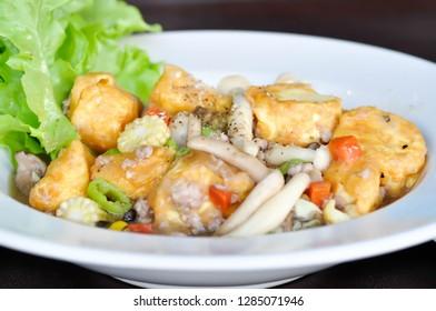 stir-fried tofu and mushroom dish