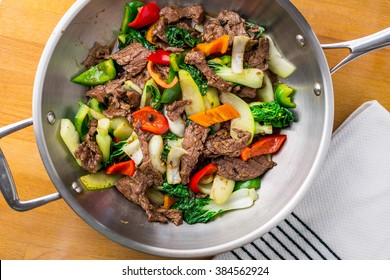 Stir-fry with beef and vegetables. Made with flank steak, peppers, onions and bok choy, stir fried in an Asian wok.