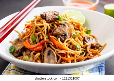 Stir-Fry Noodles / Chow Mien in a White Bowl with Chopsticks