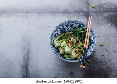 stir-fry spicy bok choy on a plate. top view from above