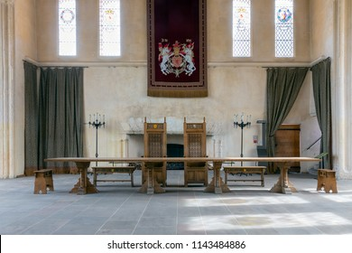 Stirling Castle, Scotland - May 19 2018: Medieval room of Stirling Castle with table, chairs and wall decorations
