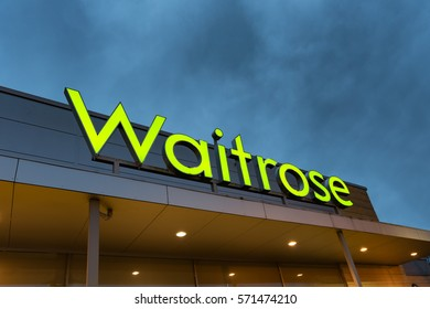 STIRLING SCOTLAND - FEBRUARY 03, 2017: A Waitrose store sign against a dark sky at dusk.