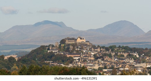 STIRLING, SCOTLAND, UK - 10 OCTOBER 2016: Stirling Castle above the town of Stirling, with two munros - Stuc a chroin (left) and Ben Vorlich (right) in the Trossachs behind,  early autumn