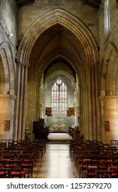 Stirling, Scotland, UK - June 8, 2018: Apse with stained glass window and Nave interior of the medieval historic Church of the Holy Rude in Stirling Scotland UK
