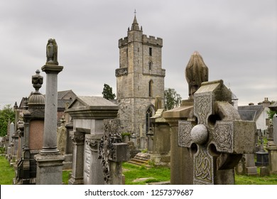 Stirling, Scotland, UK - June 8, 2018: Church of the Holy Rude with Bell tower and Royal Cemetery with historic gravestones crosses and granite memorials on Castle Hill Stirling Scotland UK