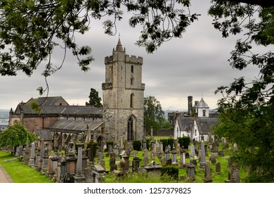 Stirling, Scotland, UK - June 8, 2018: Church of the Holy Rude with Bell tower and Royal Cemetery with historic gravestones Cowane's Hospital and Town Jail in Stirling Scotland UK