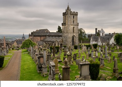 Stirling, Scotland, UK - June 8, 2018: Church of the Holy Rude or Holy Cross with Bell tower and Royal Cemetery with historic gravestones on Castle Hill above Stirling Scotland UK
