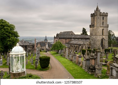 Stirling, Scotland, UK - June 8, 2018: Church of the Holy Rude with Bell tower and Royal Cemetery with historic gravestones and memorials on Castle Hill above Stirling Scotland UK