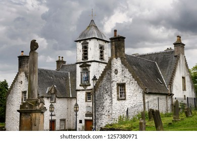 Stirling, Scotland, UK - June 8, 2018: 17th Century Burgh architecture of Cowanes Hospital with statue of John Cowane at Holy Rude Old Town cemetery on Castle Hill of Stirling Scotland