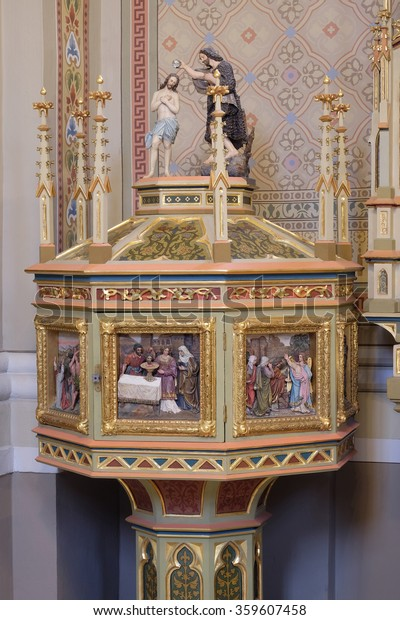 STITAR, CROATIA - AUGUST 27: Baptismal font in the church of Saint Matthew in Stitar, Croatia on August 27, 2015