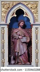 STITAR, CROATIA - JUNE 24: St. Luke the Evangelist statue on the pulpit in the church of Saint Matthew in Stitar, Croatia on June 24, 2017.