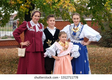 STITAR, CROATIA - OCTOBER 28, 2018: People dressed in folk costumes go to the church at the Mass on Thanksgiving day in Stitar, Croatia