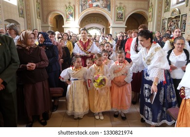 STITAR, CROATIA - OCTOBER 28, 2018: People dressed in traditional regional folk costumes in the church at the Mass on Thanksgiving day in Stitar, Croatia