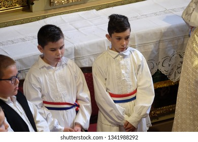 STITAR, CROATIA - OCTOBER 28, 2018: Boys dressed in traditional regional folk costumes in the church at the Mass on Thanksgiving day in Stitar, Croatia